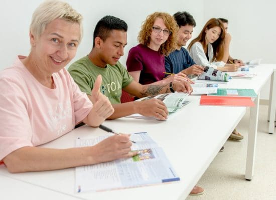 Young adults in class_Atlas
